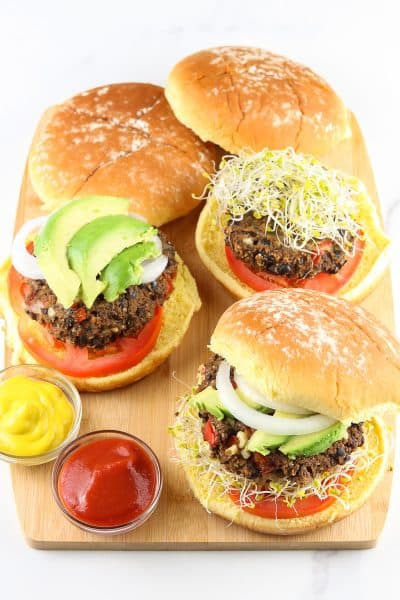 Cutting board with black bean burgers.