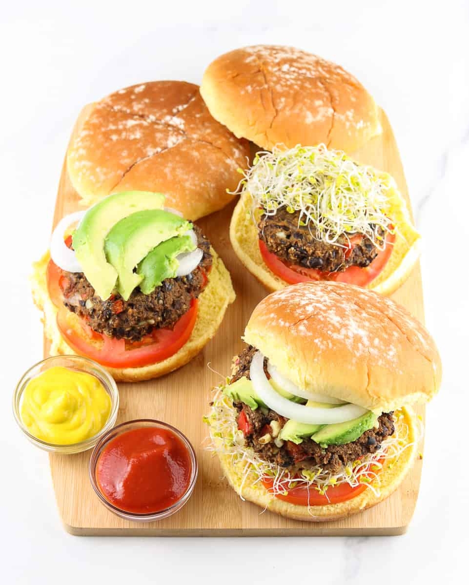 Cutting board with black bean burgers.