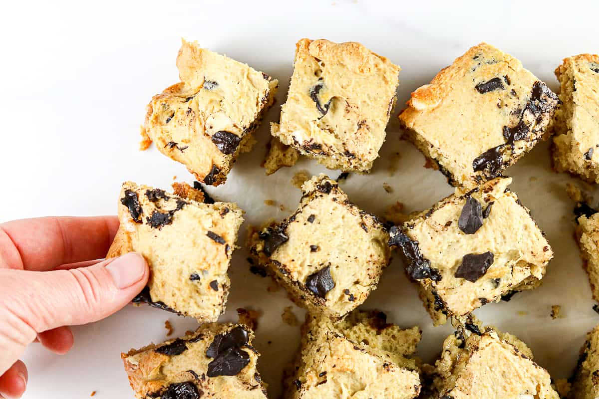 Image of hand grabbing a cookie dough bar.