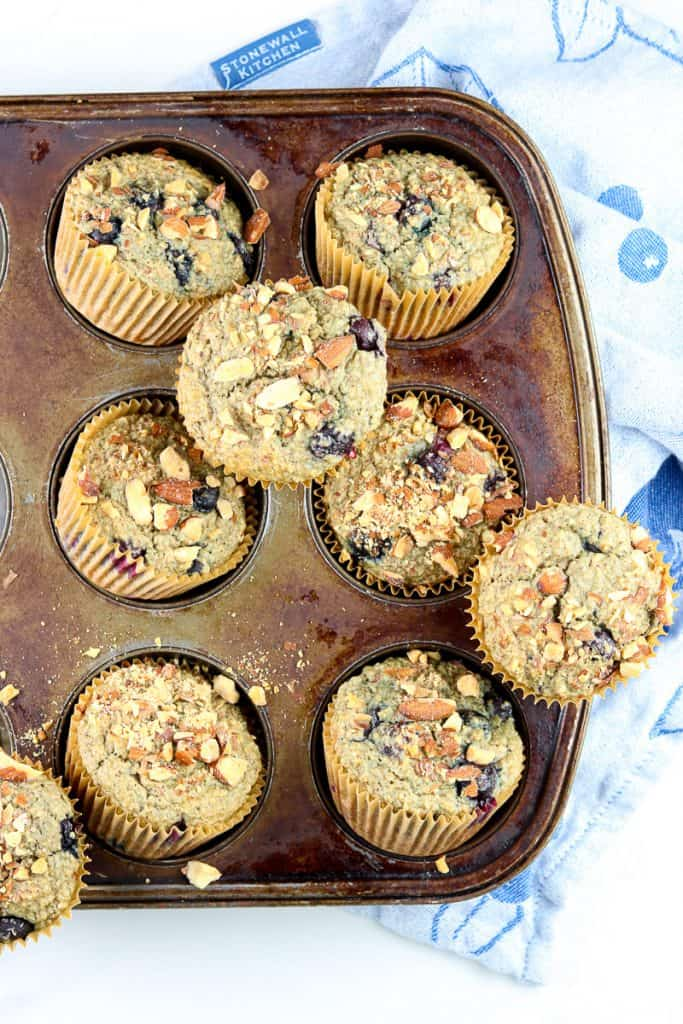 Vertical image of blueberry muffins.