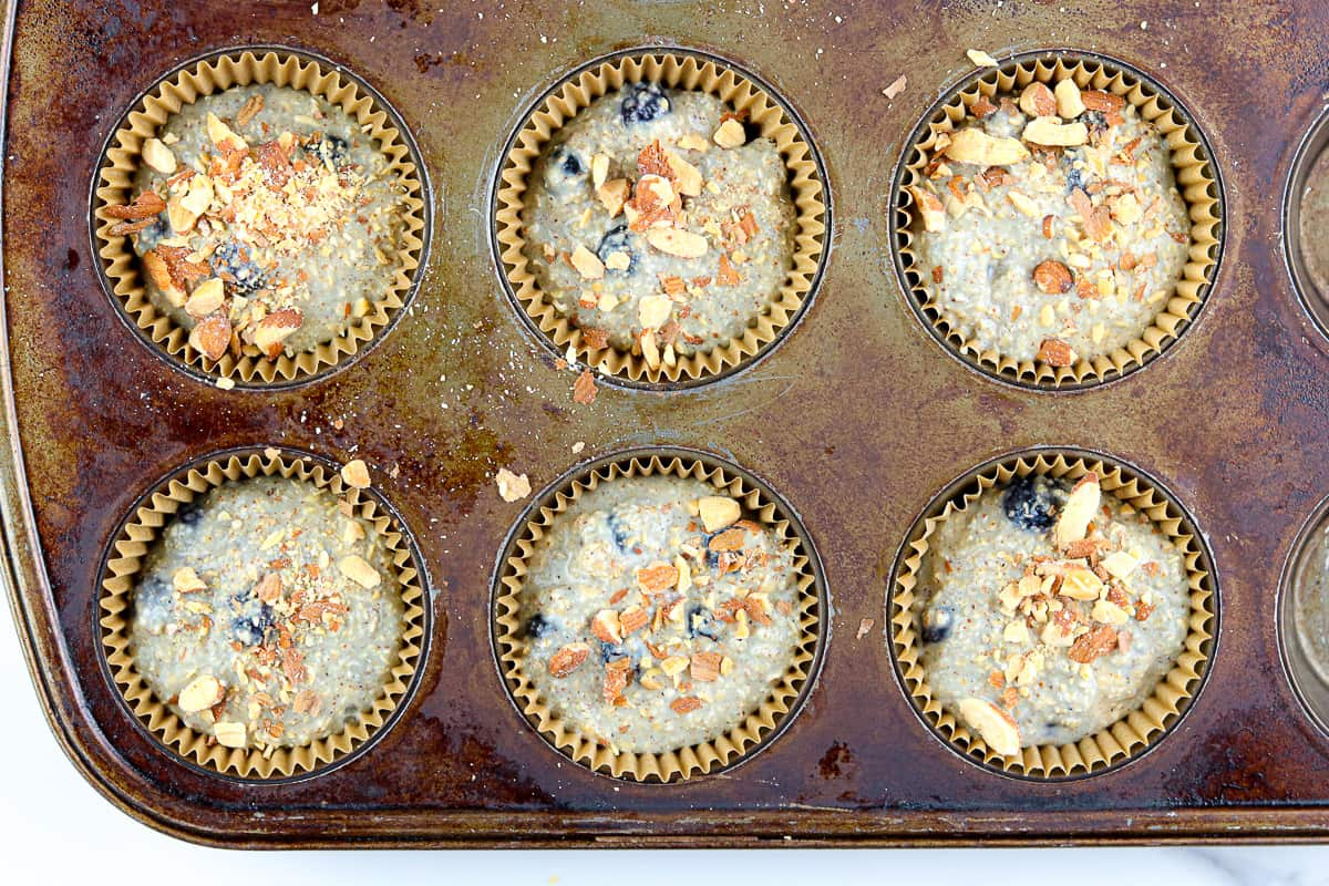 Muffin batter in tins before baking.