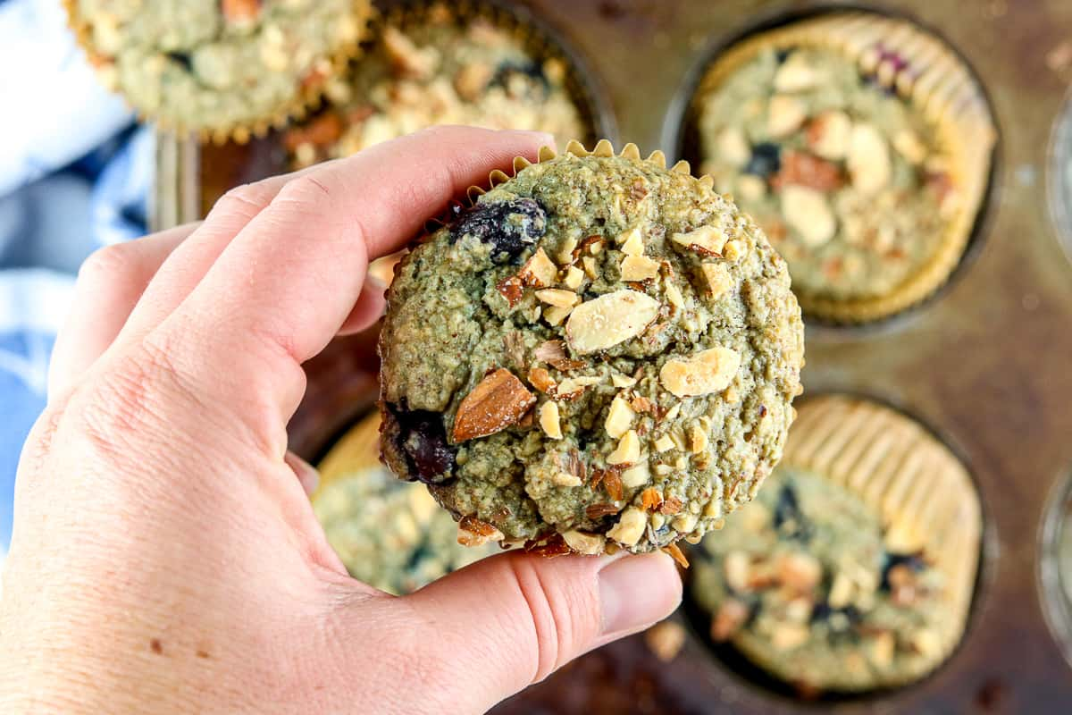 Holding a blueberry muffin up close.