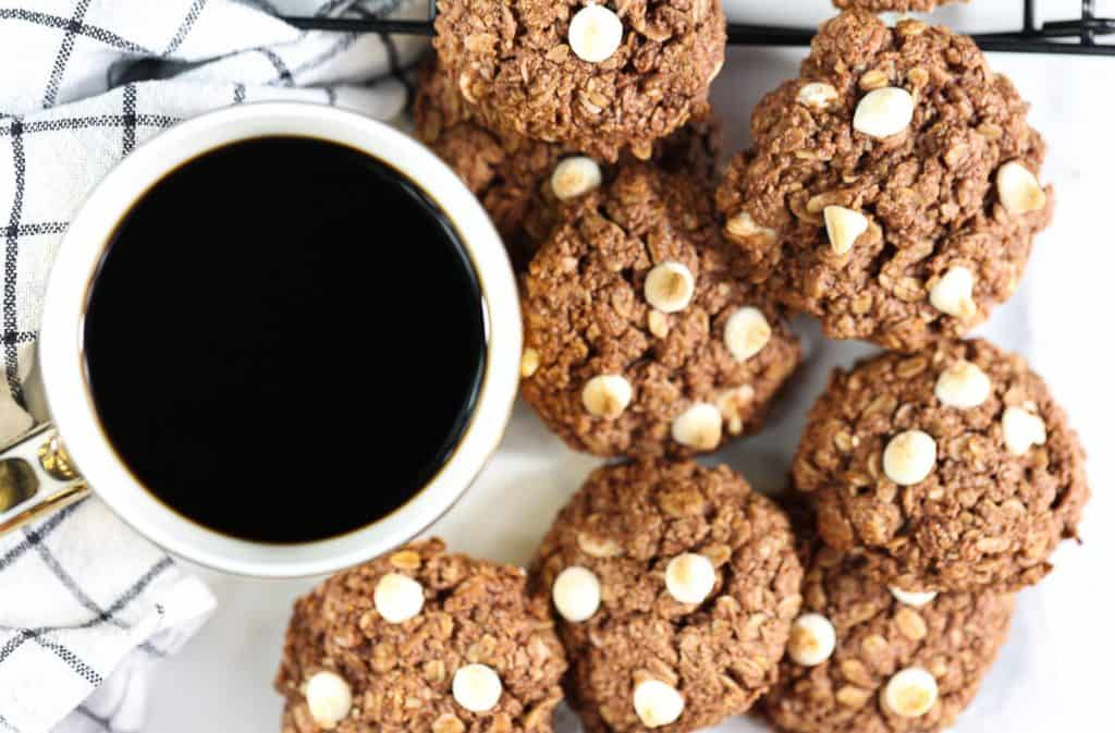 Plated shot of cookies and coffee.