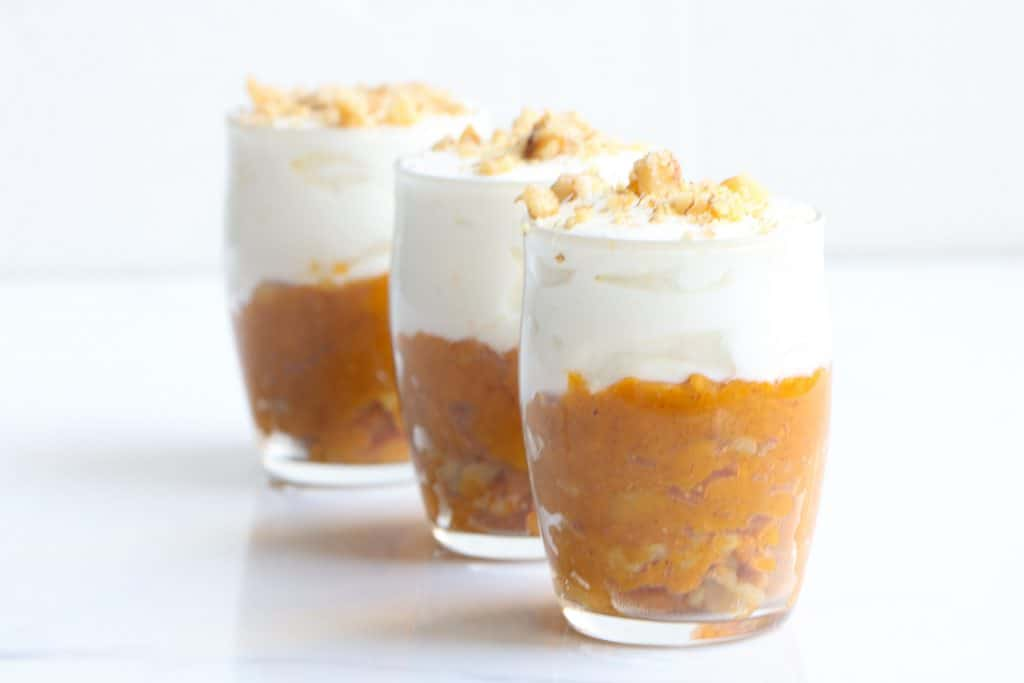 three sweet potato breakfast parfaits lined up in a row