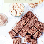 Chocolate Peanut Butter Protein Bars - A high protein snack post workout or just because! Can be made vegan with an alternative protein powder. Requires no baking! #nobakeproteinbars #chocolatepeanutbutterproteinbars #proteinbarrecipes