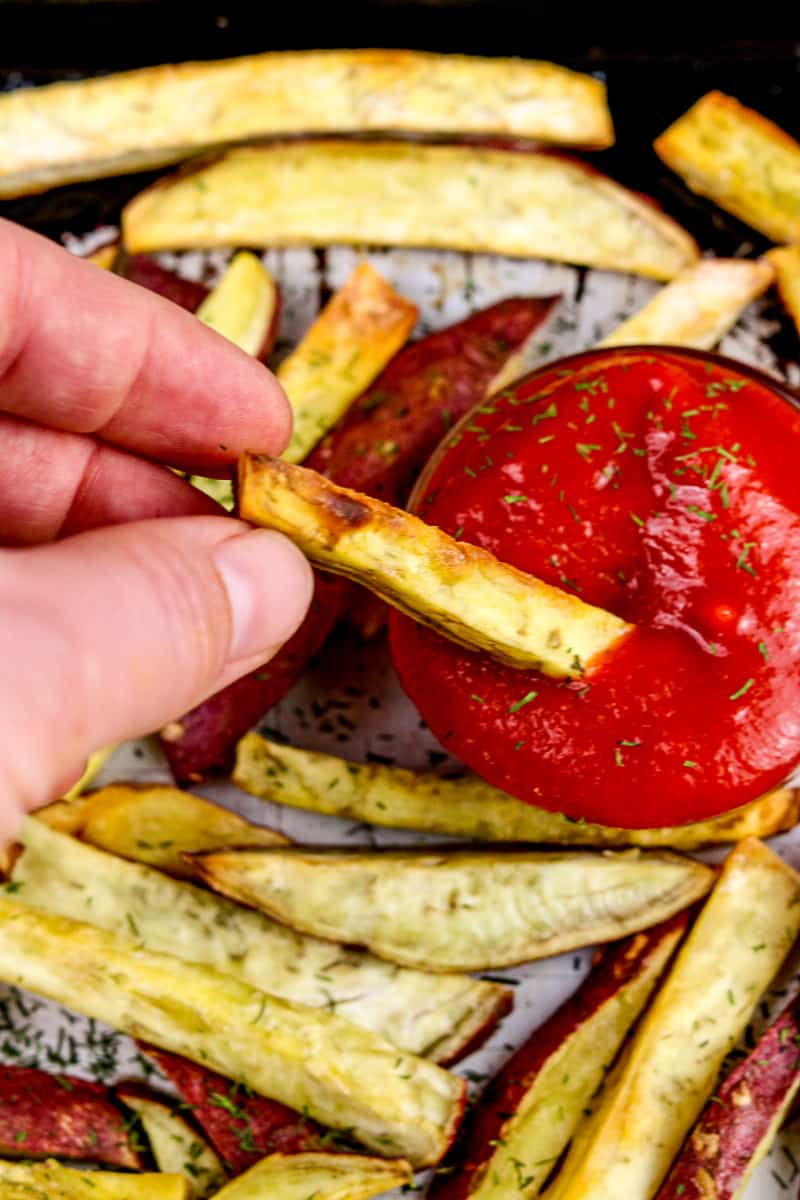 Image of fry dipping into ketchup.
