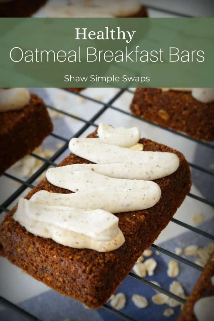 Healthy oatmeal breakfast bars with homemade icing on a tray.