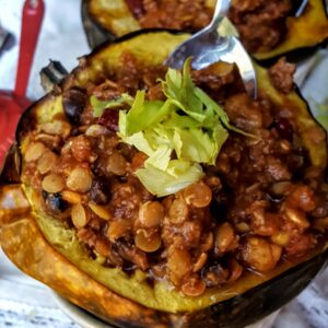 Red Lentil Chili in an Acorn Squash is the perfect plant based power bowl that takes just like fall! Gluten free, vegan too!-@shawsimpleswaps