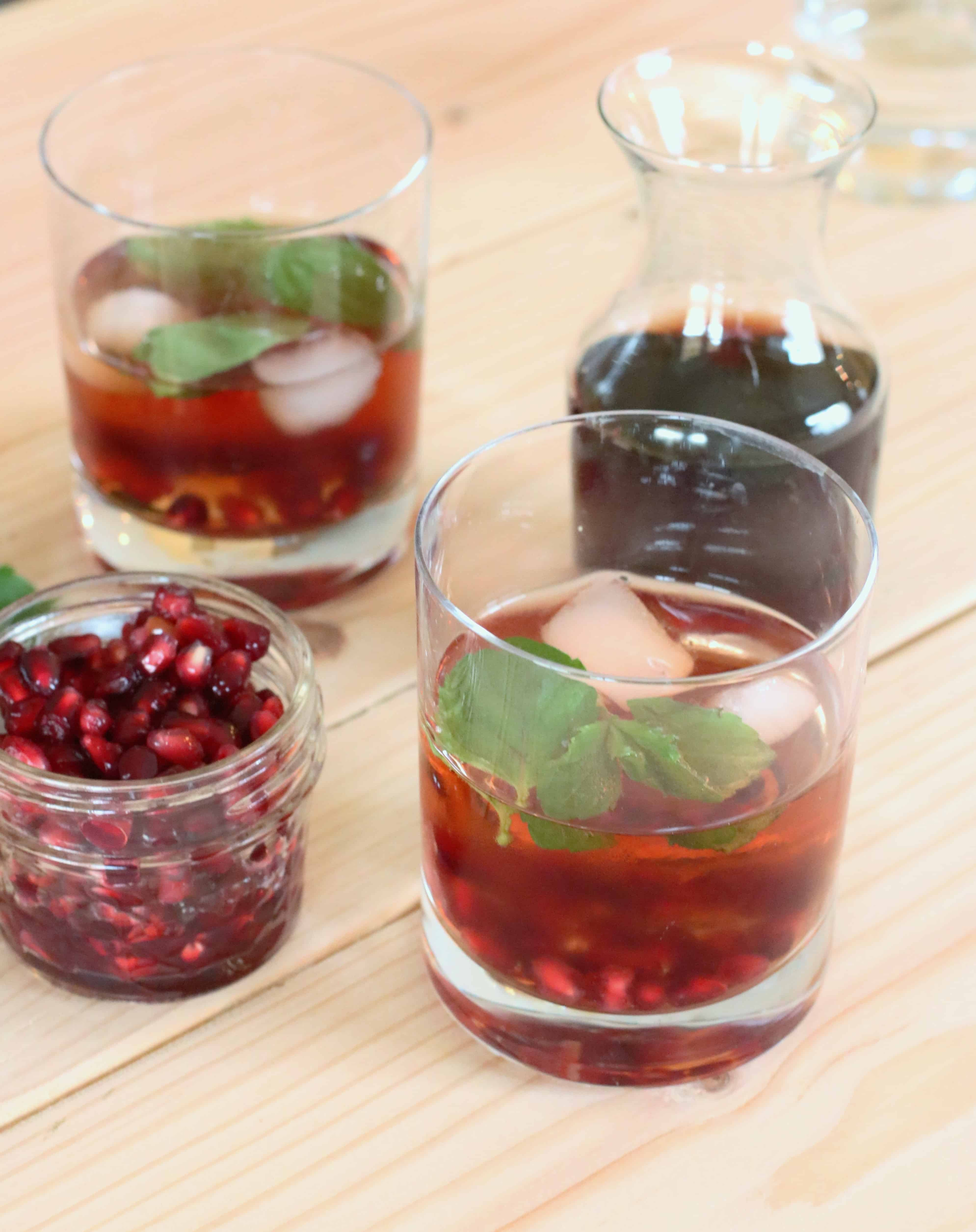 • In a cocktail shaker (or a mason jar with a lid), mix vodka, pomegranate juice, and club soda with ice. In the bottom of a festive glass, muddle 3 mint leaves with 1 teaspoon pomegranate arils. Strain Pomsettia mixture into the glass and garnish with a mint leaf and pomegranate arils, if desired.