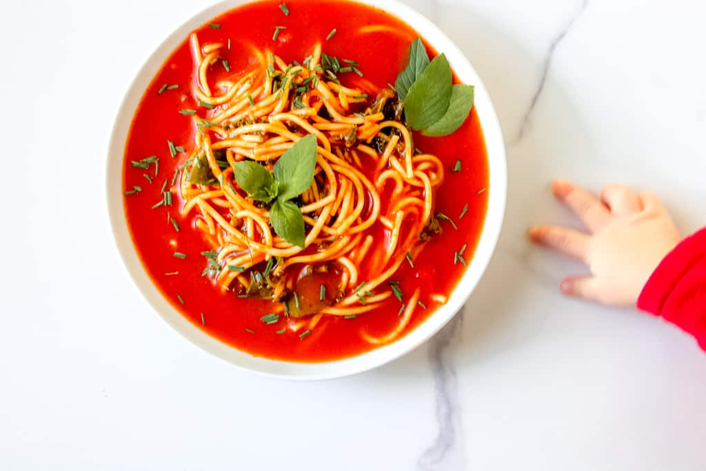 Tomato Soup Pasta with Kale is a simple, vegan dish that the entire family can enjoy. Make It from scratch or simple swap some time with using a canned soup. Either way, the end product is delicious! You'll also find suggestions to modify for a gluten-free diet and high protein soup. #tomatosoup #healthytomatosoup #vegansouprecipes