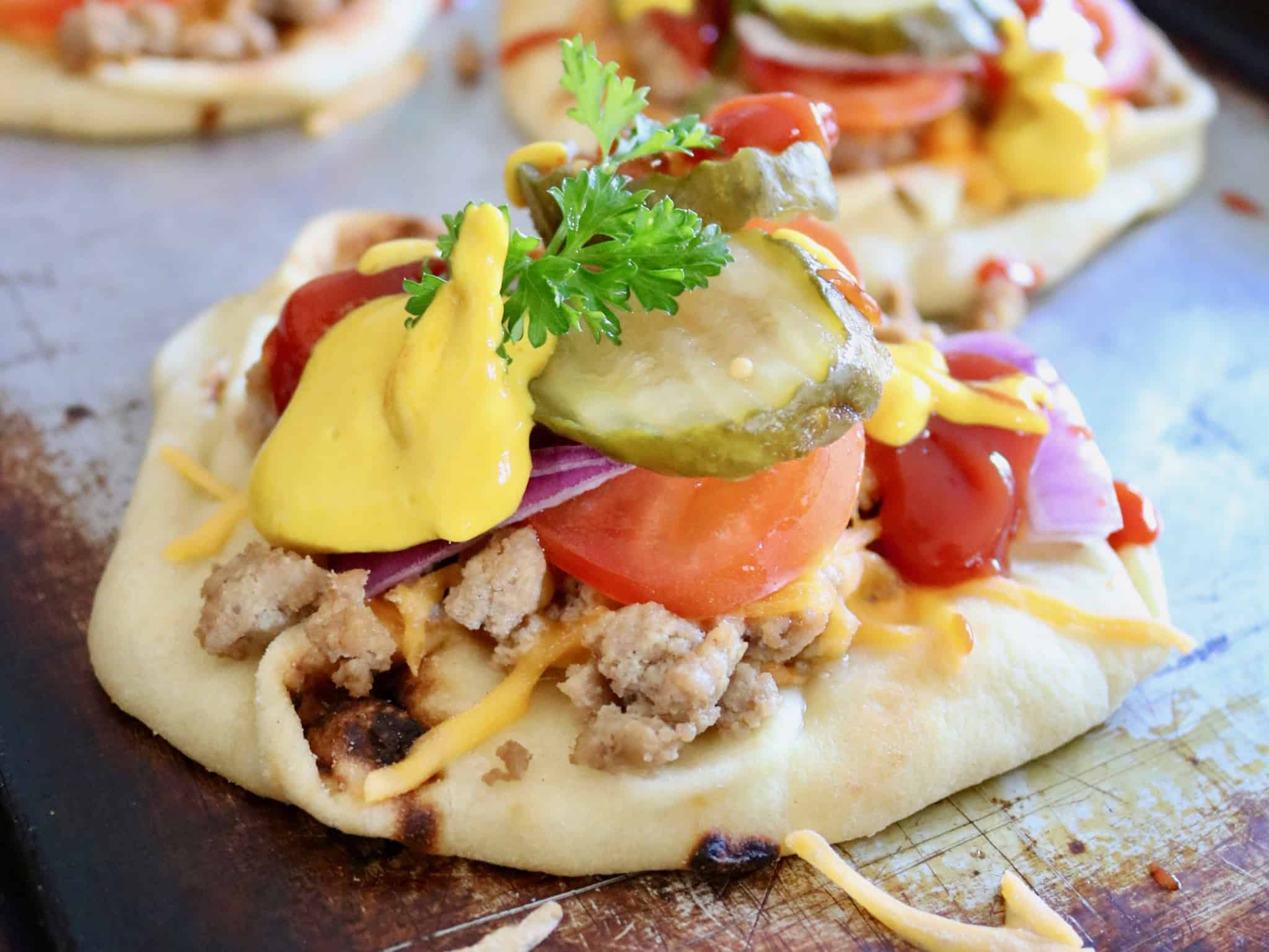 Cheeseburger Naan Pizza - A healthier way to enjoy two of your favorite comfort foods! @shawsimpleswaps