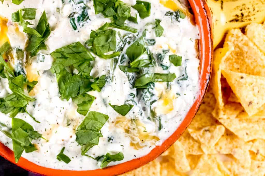Plated spinach dip with chips.