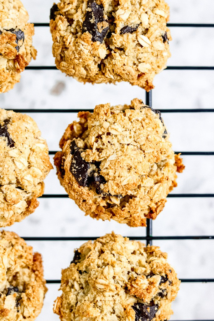 These Gluten Free Vegan Cookies are perfect for those looking for a small batch, easy and healthy recipe to whip up in under 30 minutes! Perfect for a crowd or a secret stash for yourself. Low in added sugar and super moist! #vegancookierecipe #glutenfreechocolatevcookie #healthycookierecipe #glutenfreecookies