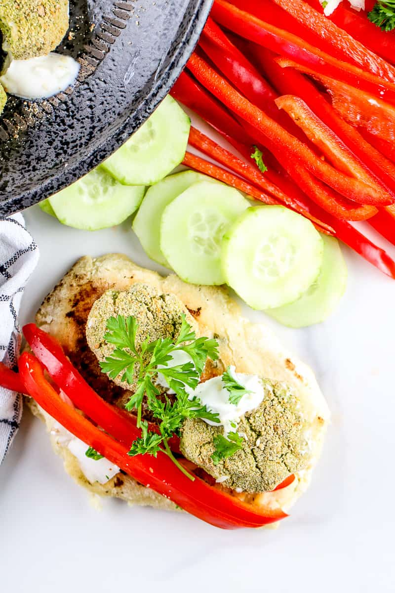 Image of plated falafel with peppers.
