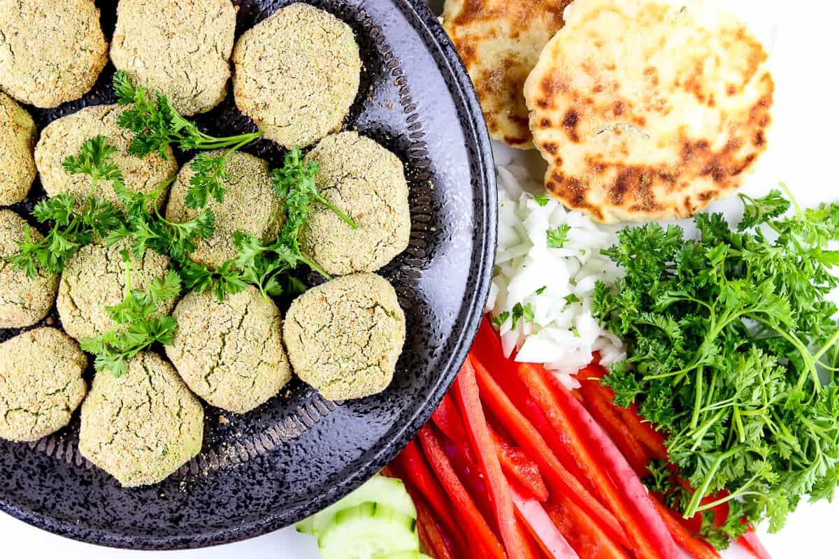 Veggie sides around falafel.