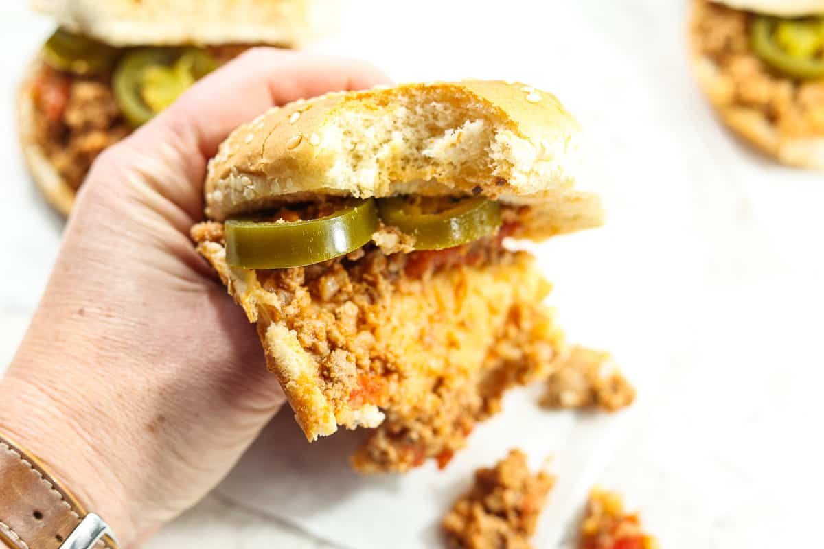 Hand holding a bun with Instant Pot Sloppy Joes