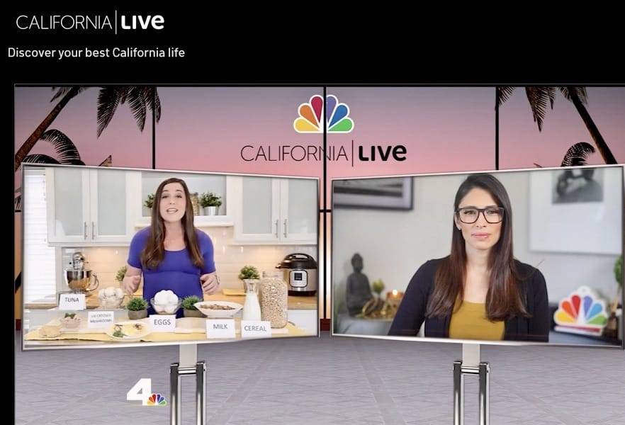 Screenshot of TV segment with two women on separate screens, one in a blue dress and white kitchen, the other in a black jacket and sitting at a desk.