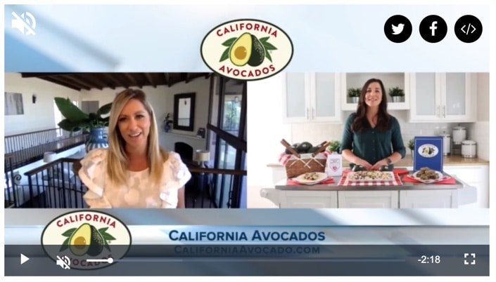 Still image of spokesperson on TV screen talking about avocados with a host and avocado logo over screen.