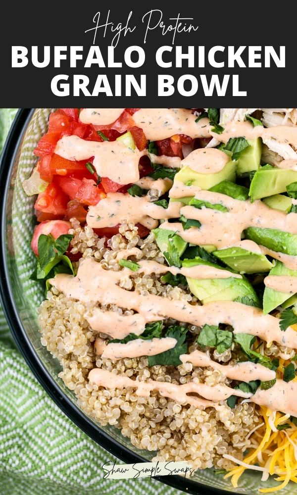 Green napkin with a glass bowl filled with veggies, chicken and tossed in red buffalo dressing on the bottom of a pin with black writing on top that reads -Buffalo Chicken Grain Bowl.