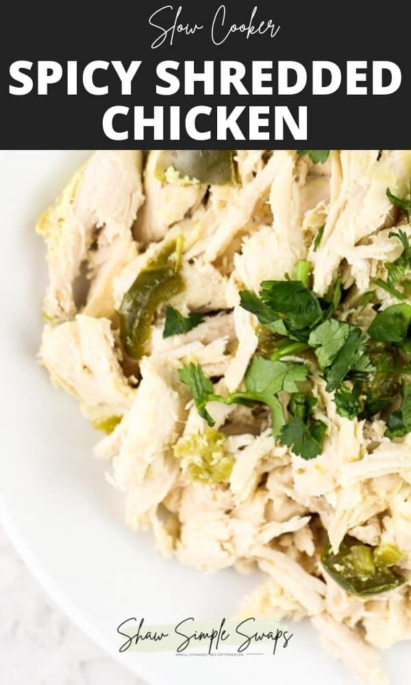 Pinterest image with black text box on top reading slow cooker spicy chicken with bottom image of a plated white bowl of shredded chicken topped with cilantro.