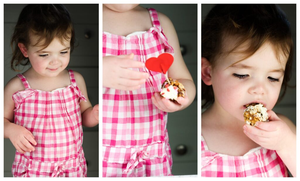 Toddler girl in pink checker board plaid smiling.