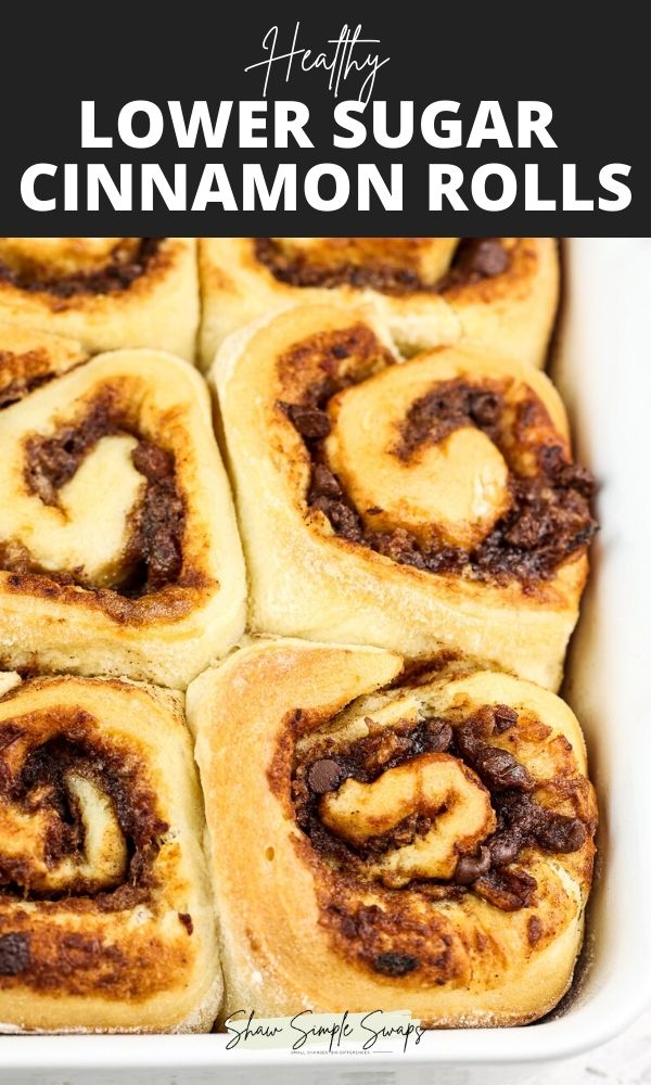 """Pinterest image with black and white text on top reading """"lower sugar cinnamon rolls."""" Brown Cinnamon Rolls in a white baking dish with a brown date filling peaking out."""
