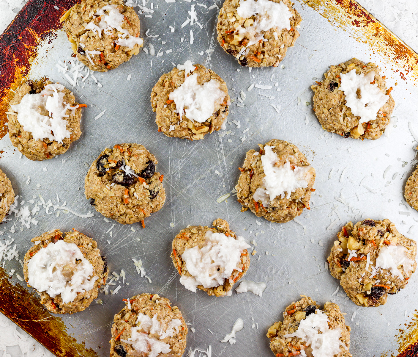 Cookies lined on a baking sheet.