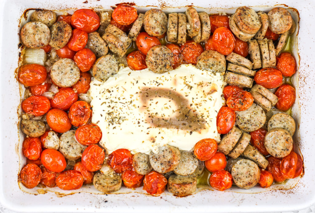 Baked cream cheese casserole with tomatoes and chicken sausage.