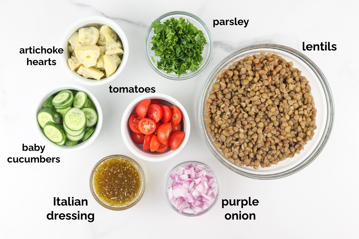 White backdrop with ingredients to make crisp lentil salad.