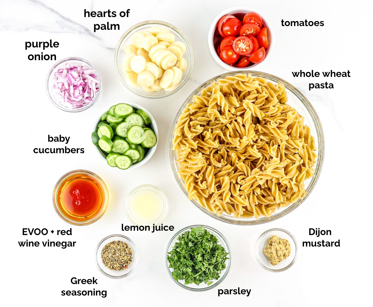 White backdrop with ingredient bowls to make Healthy Mediterranean Pasta Salad