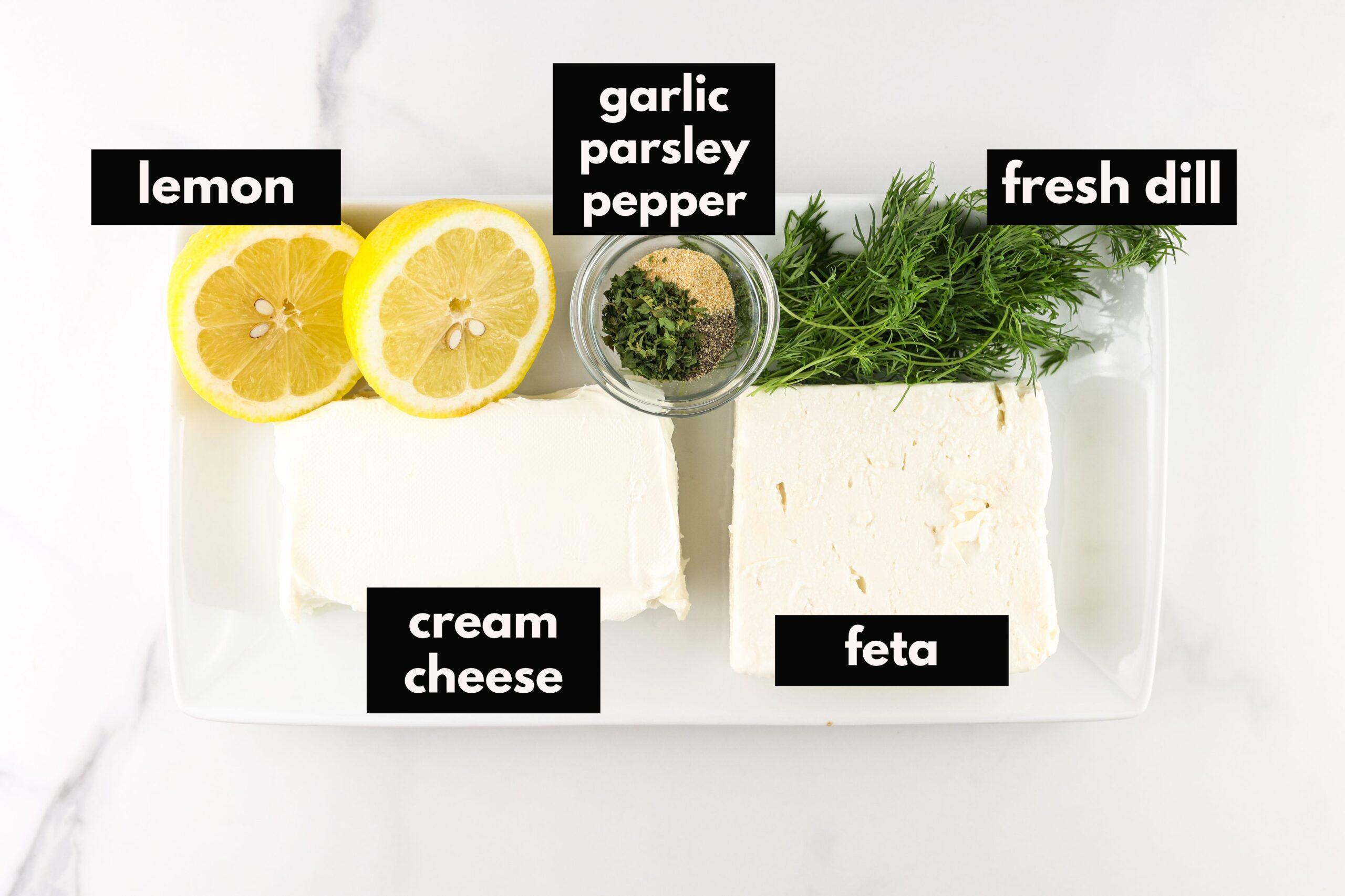 Ingredients for creamy feta dip dip on a platter.