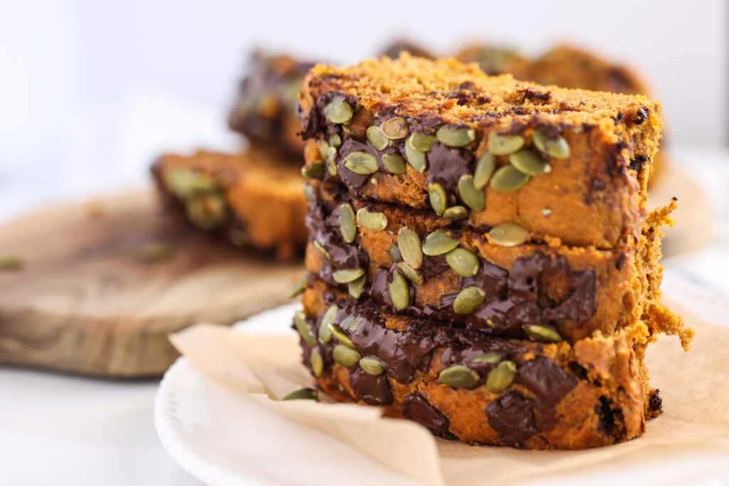 Close up of stacked chocolate bread with pumpkin.